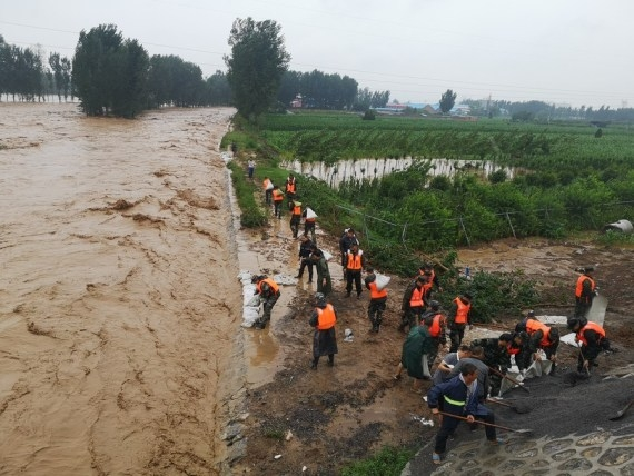 The Weekend Leader - Death toll from floods in China's Henan reach 302