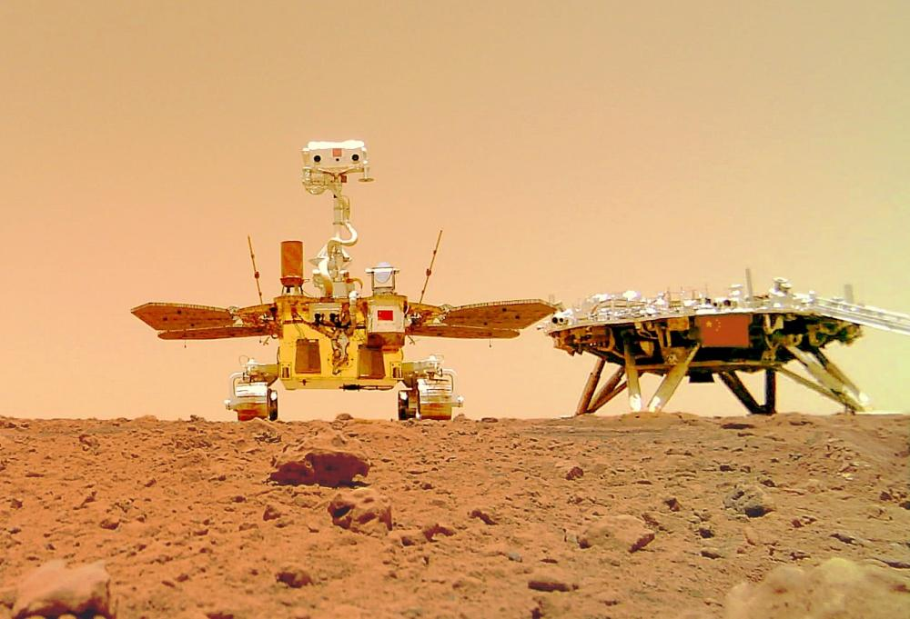 The Weekend Leader - China's Mars rover sends 1st selfie, 'touring' group photos