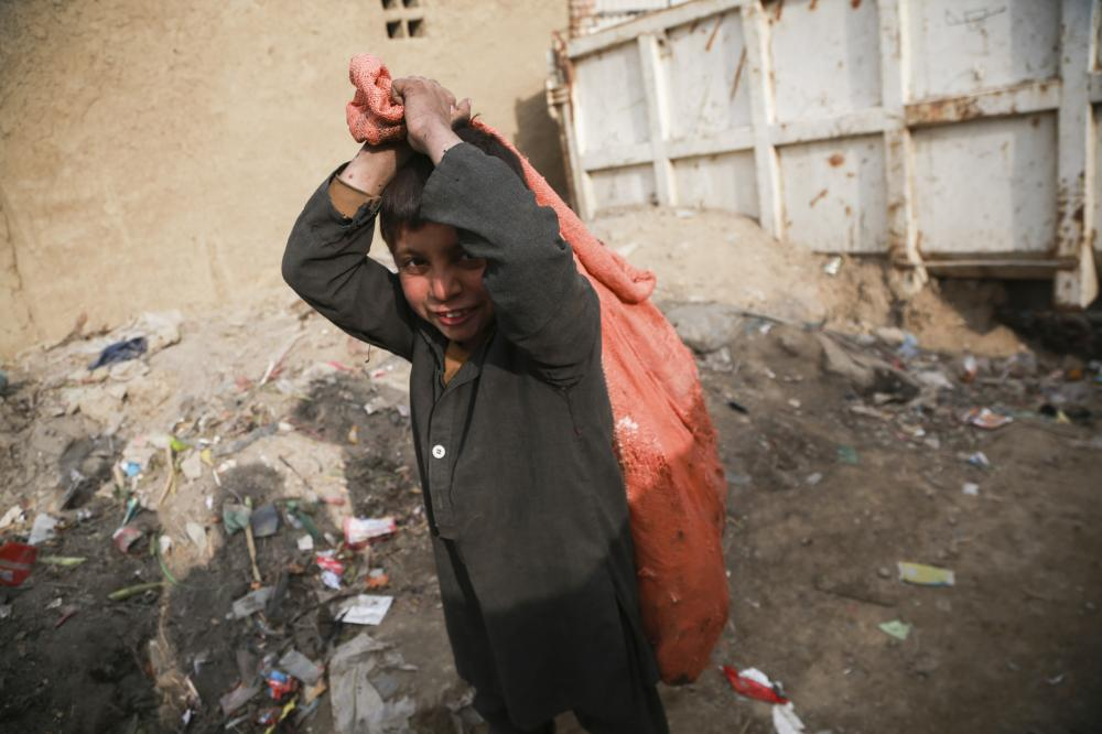 The Weekend Leader - Continued war, poverty force Afghan kids to work on streets