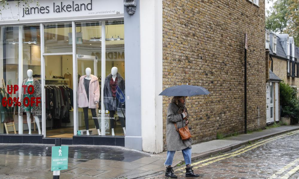 The Weekend Leader - UK retail sales fall despite further easing of curbs