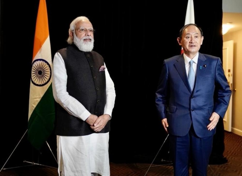 The Weekend Leader - Modi, Suga agree to promote defence, security cooperation
