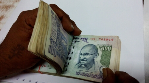 Rupee hits new record low of 76.82/$