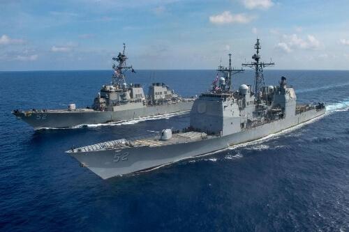 US warships sail through South China Sea, hold exercises