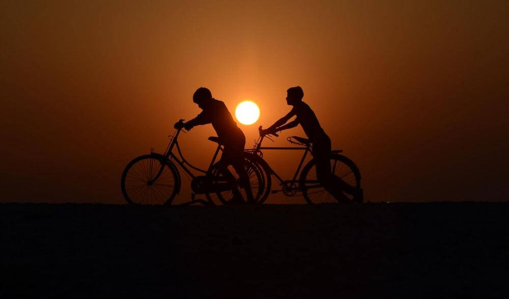Four migrant workers embark on bicycles from Vijayawada to Agra