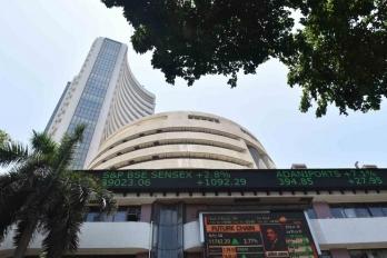 Sensex ends at record closing level amid choppy trade