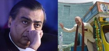 A war between the world's richest man and India's richest man