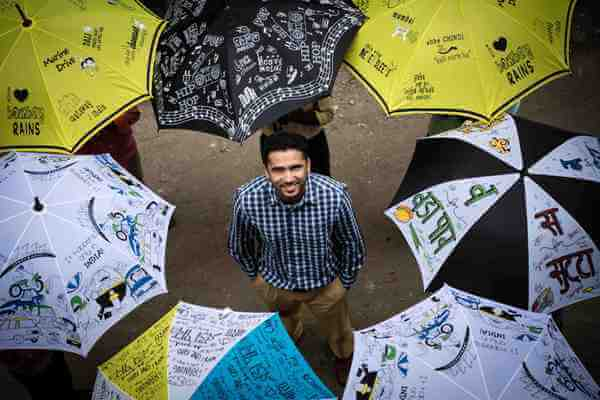 An umbrella to maintain social distancing in Kerala villages
